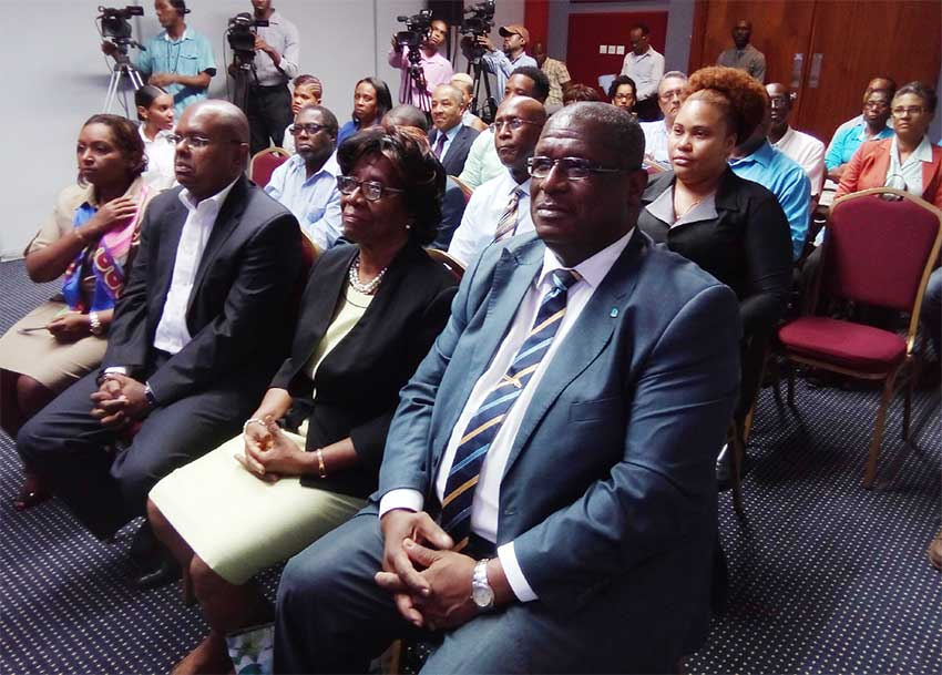 Image of Rambally (far left, front row) among other attendees at the book launch.