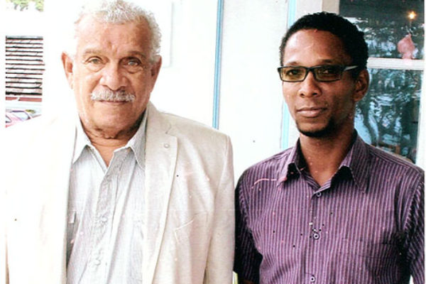 Image of Sir Derek Walcott and I at the launch of Nobel Laureate Week at Government House, January 2013.