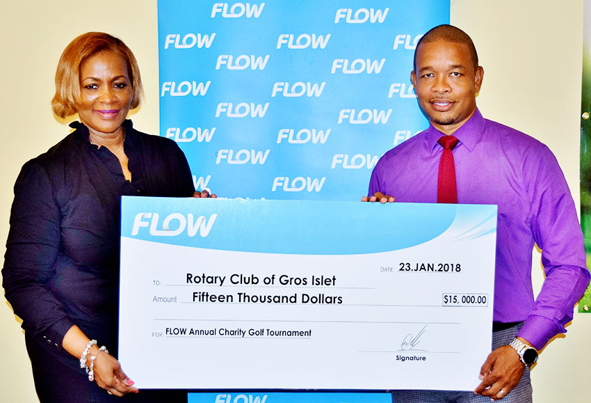 Image: Flow Communications Specialist, Terry Finisterre, presents the sponsorship cheque for the 2018 Golf Tournament to Rotary Club of Gros Islet president, Angela Clarke.