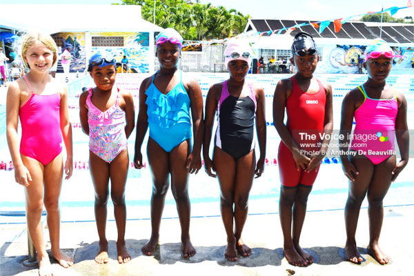 Image: First timers and future swimming stars at Sunday Independence Challenge pose for a photo moment. (PHOTO: Anthony De Beauville)