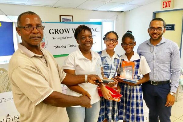 Image: Grow Well President Paul Lorde, left, presents trophy to Montessori Centre winners and teachers.