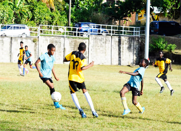Image: Some of the action in the drawn game between Northern United FC and Flow Lancers FC on Saturday. (PHOTO: Anthony De Beauville)