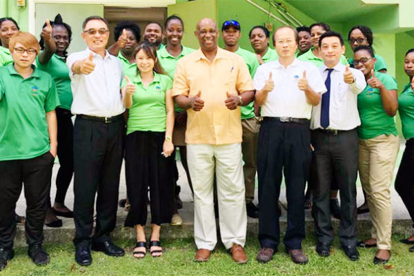 Image: A H.E. Ambassador Douglas Shen (3rd from Left) together with Chairman of the Board / Managing Director Hubert Emmanuel and his entire staff.