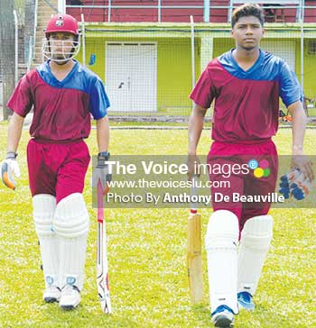 Image: (L-R) Dominic Auguste and Chaz Cepal resuming their innings after the lunch break (PHOTO: Anthony De Beauville)