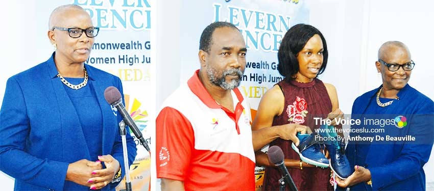 Image: (L-R) SLOC President Fortuna Belrose; SLOC General Secretary and President Alfred Emmanuel and Fortuna Belrose receiving the winning pair of shoes from Levern Spencer. (PHOTO: Anthony De Beauville)