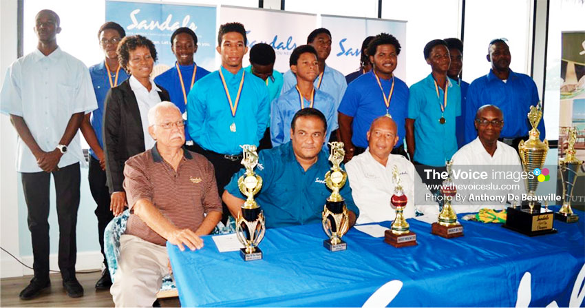 Image: (seating l-r) Photo moment with the champion team former renown cricket commentator Joseph 'Reds' Perreira, Sandals Regional PR Manager -Sunil Ramdeen, Sandals Managing Director -Winston Anderson and SLNCA President - Julian Charles (Photo: Anthony De Beauville)
