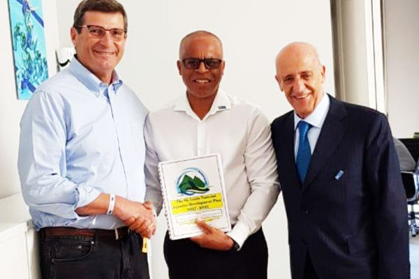 Image of Eddie Hazell presenting Saint Lucia's Five Year Aquatic Development Plan to FINA's President at the opening of the new FINA headquarters. (PHOTO: SLASA)