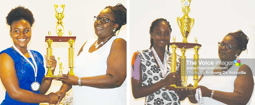 Image: (L-R) Saint Lucia female basketball captain and netball captain receiving the second and first place trophy from Director of Youth, Mary Wilfred. (PHOTO: Anthony De Beauville)