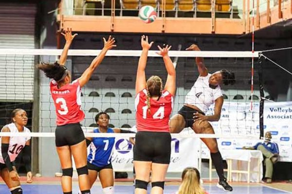 Image of Saint Lucia's Lisa Casimir (No.4) going airborne as she hit a powerful spike against Bermuda (Photo: ECVA)