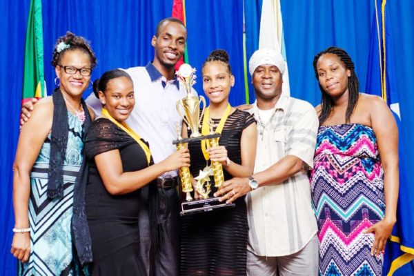 Image: UNTOUCHABLE! The winning Saint Lucia team with trophy after defeating rivals from six other participating countries.