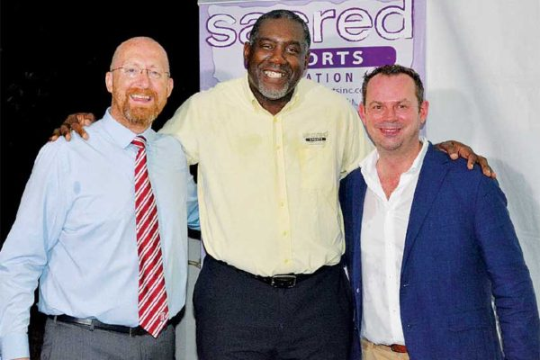 Image: (L-R) Carl Bennett – Stake City Foundation, Delroy Alexander – Sacred Sports Foundation and Resident British Commissioner, Steve McCready. (PHOTO: SHF)