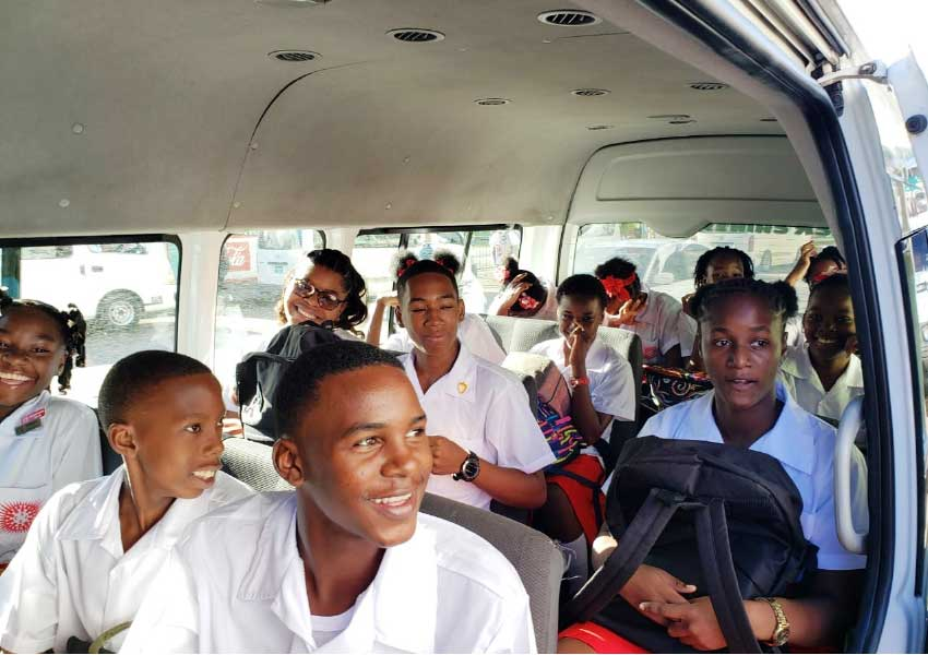 Image: FREE RIDE! Students boarded buses for free rides to school on first day back at class.