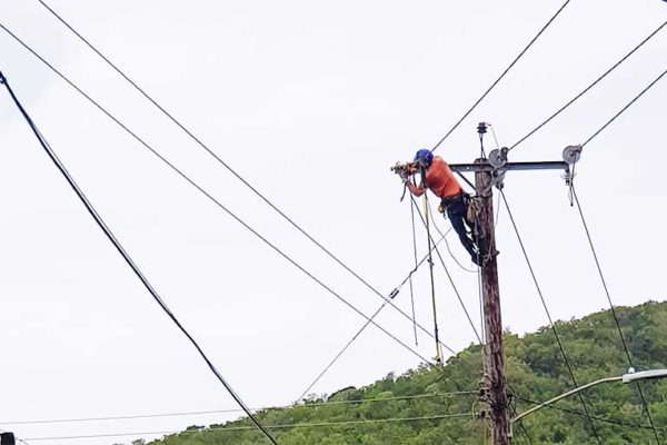 "Image: Electricity was blacked-out on Thursday night and early Friday morning, but LUCELEC crews island-wide ensured all could switch the lights back on by midday yesterday. (PHOTO: Kendell ""Scady"" Eugene)"