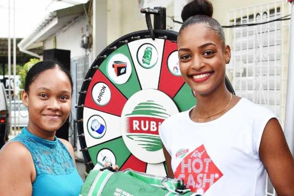 Image: One lucky customer all in smiles. (PHOTO: Rubis)