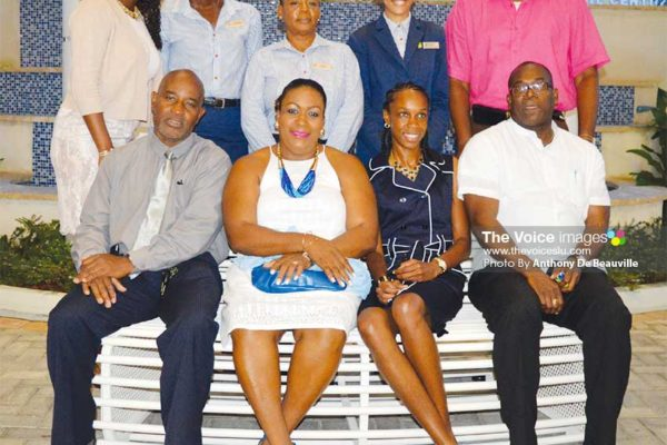 Image: (BACK ROW L-R) – Pamela Nurse and other members of staff, Levern's Manager, Gregory Dickson - (FRONT ROW L-R) Director For Youth Development and Sports – Patrick Mathurin, Deputy Permanent Secretary - Liota Charlemagne-Mason, Levern Spencer and Minister for Youths Development and Sports Edmund Estaphane. (PHOTO: Anthony De Beauville)