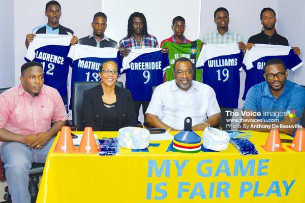 Image: (BACK ROW) - members of the Gros Islet football team displaying their new playing top; (FRONT ROW L-R) Shayne Paul - President GIFL, Francillia Scott - CEO Saint Lucia Air Freighters, Larry Scott - CEO Scotts Sports Shops and Awards, Charde Desir - 1st Vice President GIFL. (PHOTO: Anthony De Beauville)
