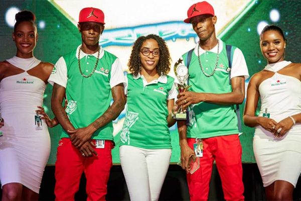Image: Heineken Green Synergy 2018 Skills Champion X factor and his MC receiving prize from Mindy-LuquianaChicot, Brand Manager at WLBL.