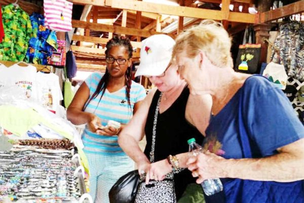Image: Tourists at Vendors' Arcade