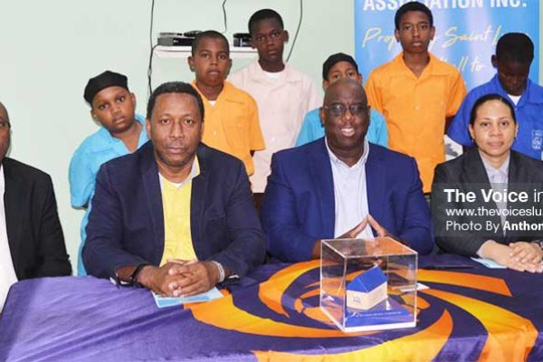 Image: (FRONT ROW L-R) photo moment for SLFA GS – Victor Reid, SLFA President – Lyndon Cooper, CONCACAF Programme Manager - Howard McIntosh, FIFA Development Coordinator – Makaila Church (Back Row) students from the various districts (Photo: Anthony De Beauville). (PHOTO: Anthony De Beauville)