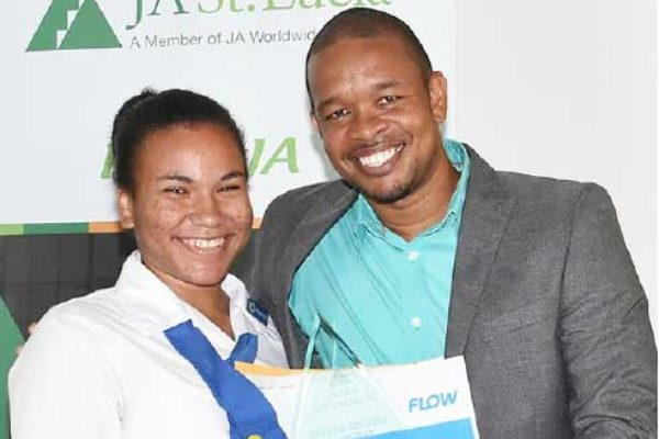 Image: 1st place National Achiever of the year goes to ZennaHadeed of the Corinth Secondary School who also got a handset compliments FLOW from Flow Communications Specialist Terry Corwin Finnisterre.