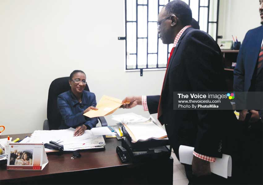 Image of Opposition Leader Philip J. Pierre submitting the draft motion to the Clerk of Parliament. (PHOTO: PhotoMike)