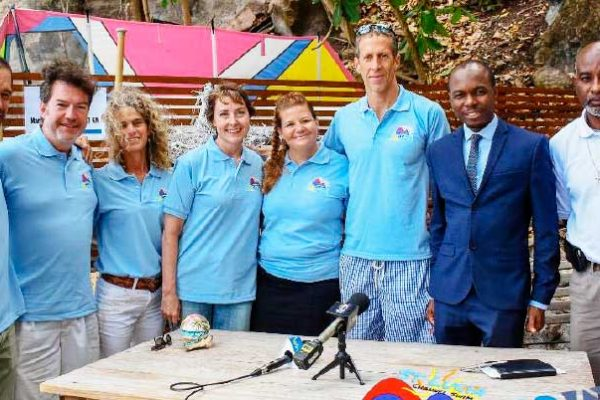 Image: (L-R) Weston Moses, Paul Nance, Lily Bergasse, Molly Nance (the eventual swimmer), Sue Dyson, Nathaniel Waring, Tourism Minister - Dominic Fedee and Director of Sports in the Department of Youth Development and Sports - Patrick Mathurin (Photo: SLCS)