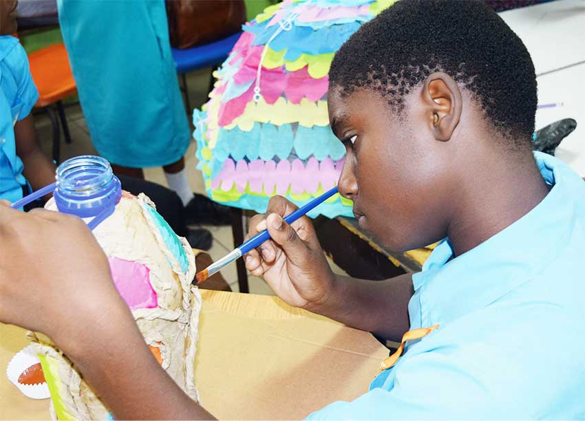 Image of a young student preparing his lantern ahead of the contest.