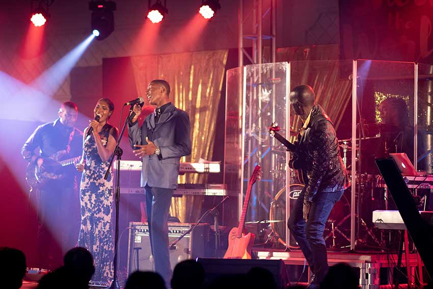 Image of Manasseh Stanislaus and Whitney Abysique performs with the legend