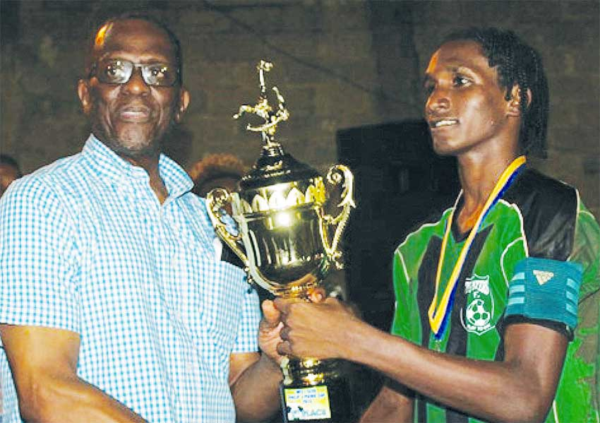 Image: (L-R) Parliamentary representative for Castries East, Phillip J Pierre presenting the championship trophy to Big Players Youth captain Shermon St. Ange (PHOTO: MFL)