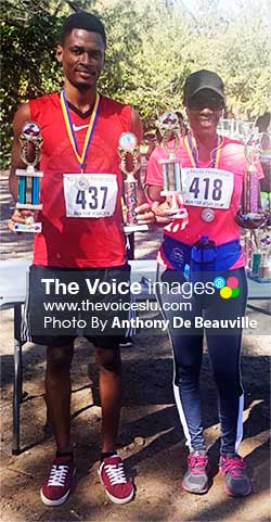 Image: (L-R) Overall male and female winner, Thaddeus George and Terry Hunte. (PHOTO: Anthony De Beauville)