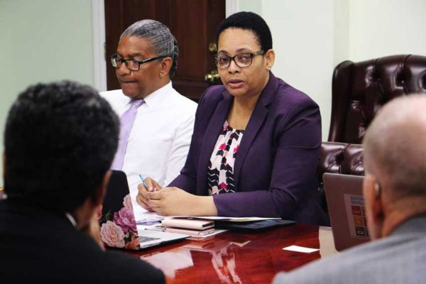 Image of Hon. Bradly Felix & Director of Finance Ms. Cointha Thomas (Photo courtesy Facebook: @allenmchastanet)