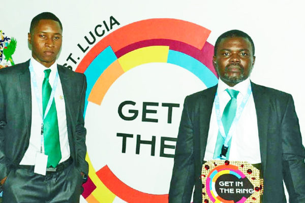 Image of Get in the ring 2018 winner Patrick Eze of Eze green (right) and Gitr 2018 wildcard winner represented by Denell Florius, Co founder of EcoCarib Inc.