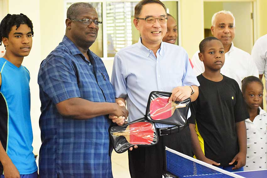 Image of Hon. Stephenson King receiving sporting equipment donation from the Taiwanese Embassy