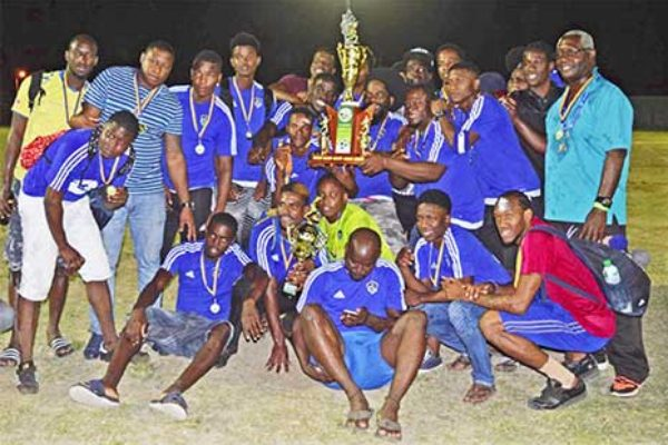 Image: (L-R) Saint Lucia representative team, Platinum; Platinum captain, Dwayne Charles receiving the 2018 championship trophy from SLFA President, Lyndon Cooper. (PHOTO: Anthony De Beauville)