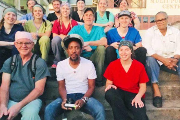 Image of Taj Weekes (centre) with volunteers.