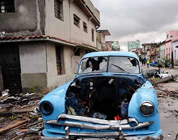 Image: Vintage vehicle among debris after tornado