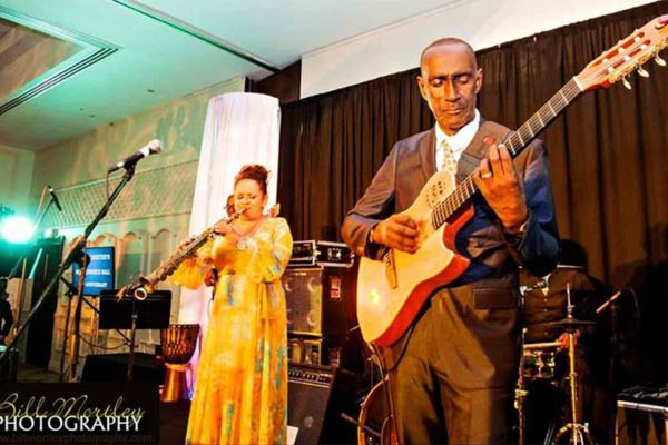 Image of a performance by Barbara Cadet and Ronald 'Boo' Hinkson.