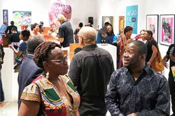 Image: The opening of the AFRO FUTURE art show by CADA & the Miami Design District.