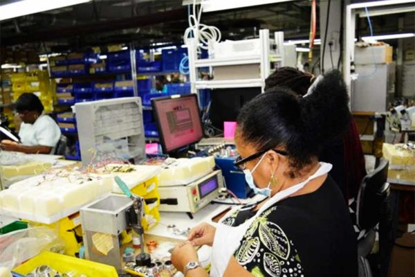 Image: Workers at API Harowe St. Kitts Ltd. busy at work.