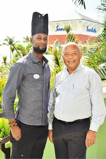 Image of Sandals Regency La Toc Resort and Spa's Chef Clayton Julien (l) and Sandals Saint Lucia Managing Director Winston Anderson.