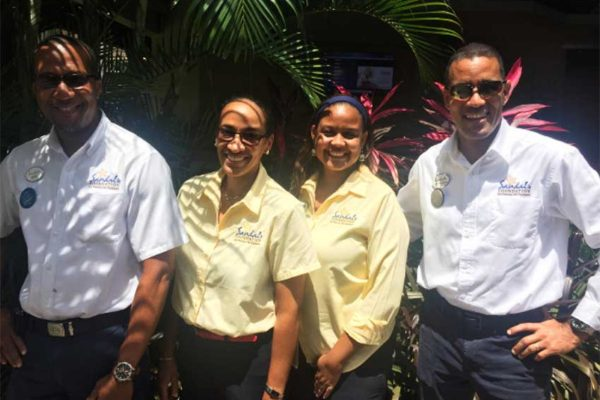 Image: (L-R) Dean Alphonse, Maintenance Supervisor of Sandals Halcyon Resort; Judy Deterville and Rhonda Giraudy (Public Relations Managers Sandals Resorts International) and General Manager of Sandals Halcyon, Christopher Elliot.