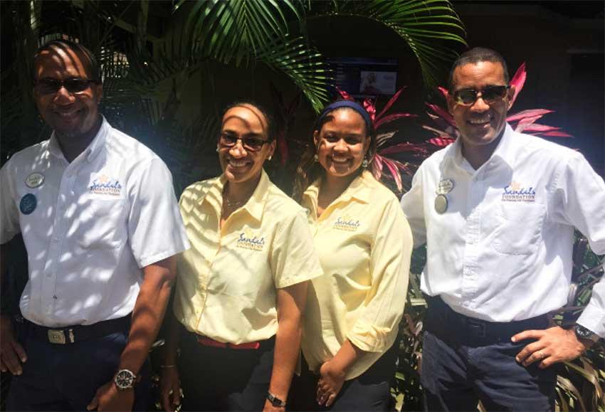 Image: (L-R) Dean Alphonse, Maintenance Supervisor of Sandals Halcyon Resort; Judy Deterville and Rhonda Giraudy (Public Relations Managers Sandals Resorts International) and General Manager of Sandals Halcyon, Christopher Elliot.