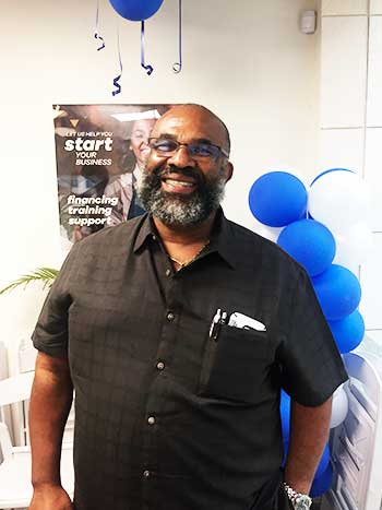 Image of Errol Le Blanc, Managing Director of Unicomer Caribbean South Sub-Region, at Courts Ready Cash Microloans launch..