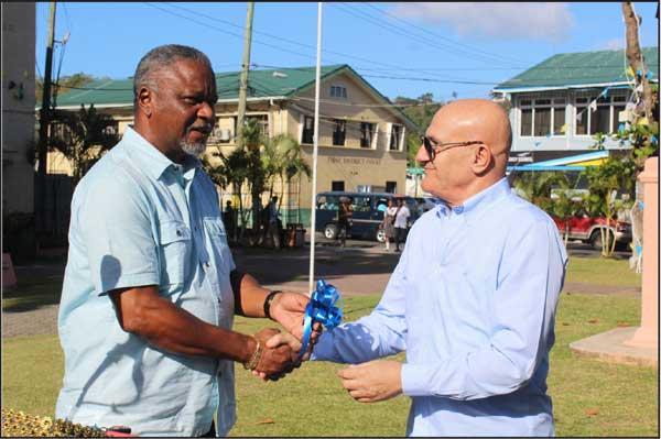 img:Maher Chreiki (right) handing over the keys to Minister of Home Affairs Hermangild Francis.