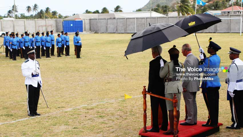 Image of Prince Charles (at right on podium) was a guest of honour at Sunday's post-Independence ceremony at the Phillip Marcellin Grounds. (PHOTO: PhotoMike]