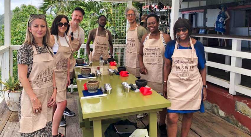 Image: Saint Lucia Jazz UK media group enjoying a chocolate making experience.