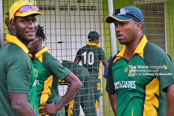 Image: (L-R) Darren Sammy and Johnson Charles planning their strategy during the water break. (PHOTO: Anthony De Beauville)
