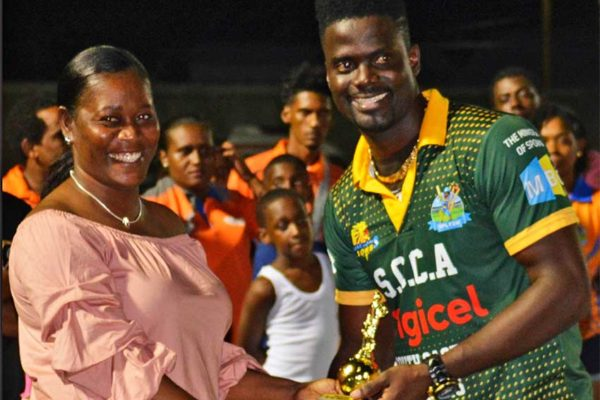 Image of Jacqueline Inglis presenting Andre Fletcher with one of his three awards