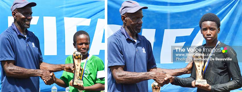 Image: (L-R) SLFA Events and Competition Coordinator, Evastus Augustin presenting the Northern United All Stars captain and FLOW Lancers FC goalkeeper with the championship and second place trophy, respectively. (PHOTO: Anthony De Beauville)