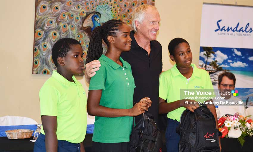 Image: A proud moment for three Grow Well young aspiring golfers, they each received a bag pack with school supplies from Greg Norman/Sandals . PHOTO: Anthony De Beauville)